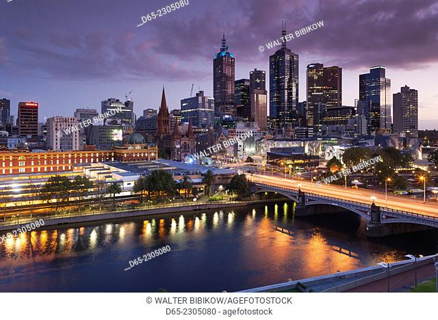 Australia, Victoria, VIC, Melbourne, skyline with Yarra River and Princess Bridge, elevated view, dusk
