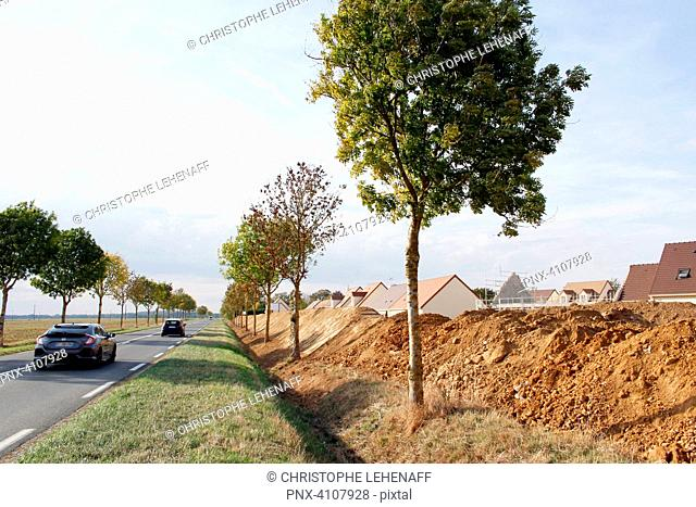 Seine et Marne. Housing development under construction. Construction of an anti-noise hillock to protect the houses from the noise of the departmental road