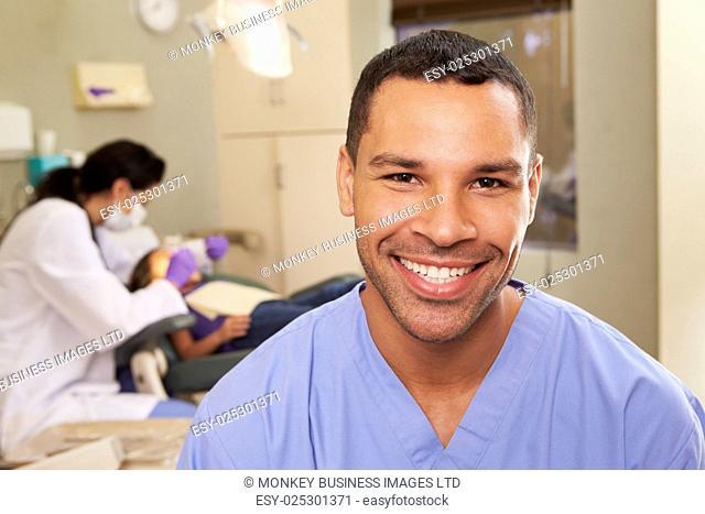 Portrait Of Dental Nurse In Dentists Surgery