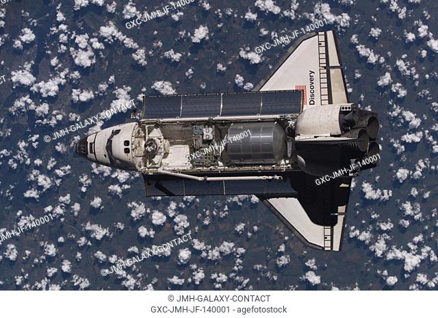One of a series of photographs showing the Space Shuttle Discovery as taken from aboard the International Space Station during rendezvous and docking operations