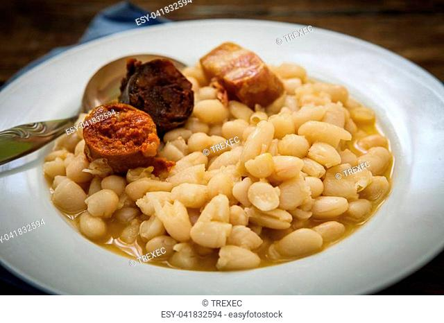 fabada is a typhical spanish legumes dish with big beans and sausage