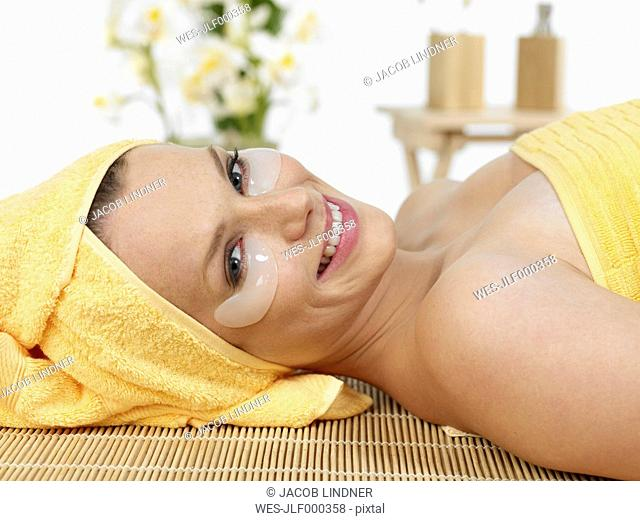 Young woman at spa, smiling, portrait