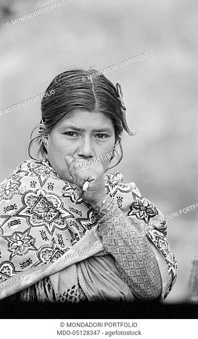 Nepalese woman smoking. Nepal, 1965
