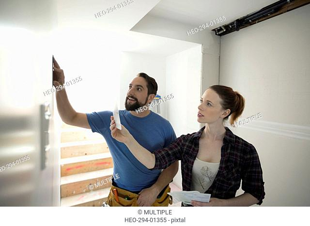Couple viewing paint swatches for home improvement project
