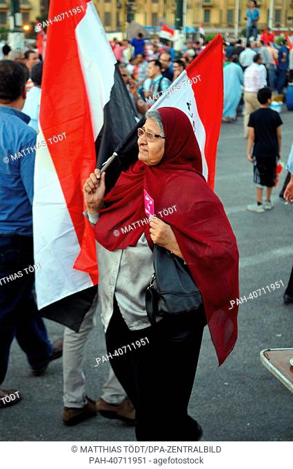 A female senior citizen attends a demonstration against Egyptian President Mursi at Tahrir Square in Cairo, Egypt, 28 June 2013