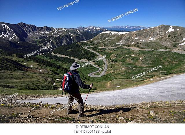Hiker looking at view of mountains at Loveland Pass in Colorado