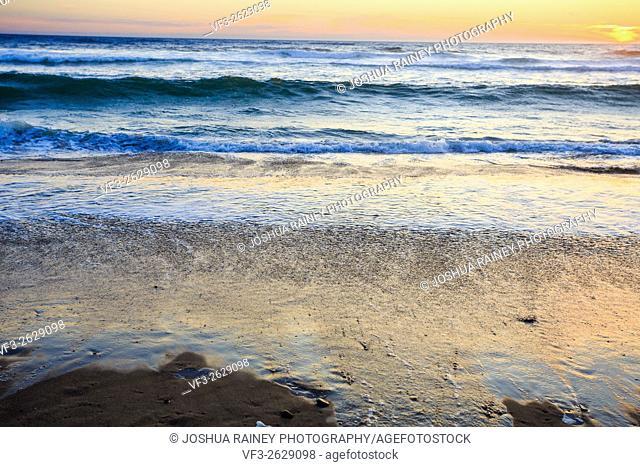 Waves crashing on an Oregon beach at sunset