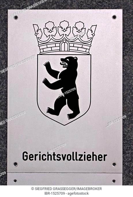 Sign, Gerichtsvollzieher, German for bailiff, with the coats of arms of Berlin, bear