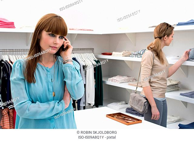 Two women in fashion boutique