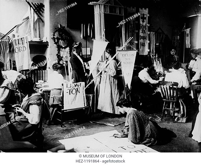Suffragettes making banners for the procession to Hyde Park on 23rd July 1910. The motto of the WSPU, (Women's Social and Political Union), 'Deeds Not Words'