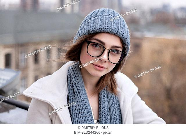 Caucasian woman wearing eyeglasses with scarf and hat
