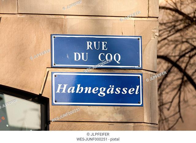 France, Strasbourg, La Petite France, road sign on facade