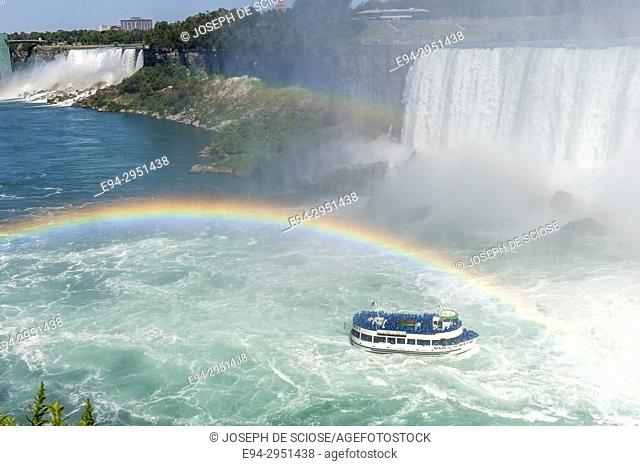 Maid of the Mist boat at Niagara Falls with a rainbow appearing in the mist, Niagara River, Ontario