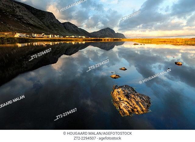 Landscape photo of a colourful sunrise on the one of Bettys Bay's many lakes. Bettys Bay, Western Cape, South Africa
