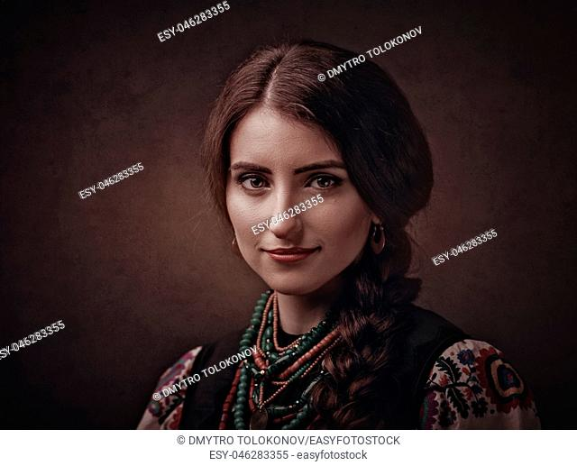Beauty female portrait with ethnic ukrainian dress and accessories