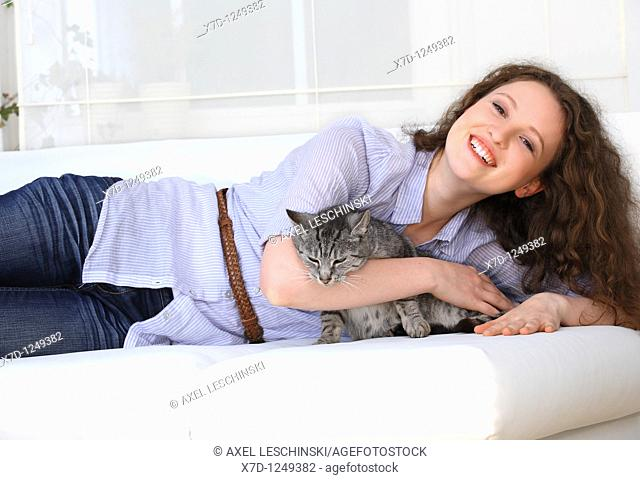 young brunette woman fondling domestic cat