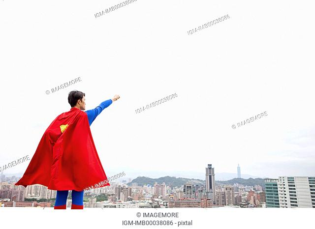 Superhero standing and looking away with fists up