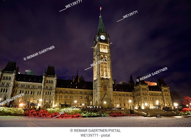 Christmas lights at Parliament Hill with lit Canadian government buidings in Ottawa