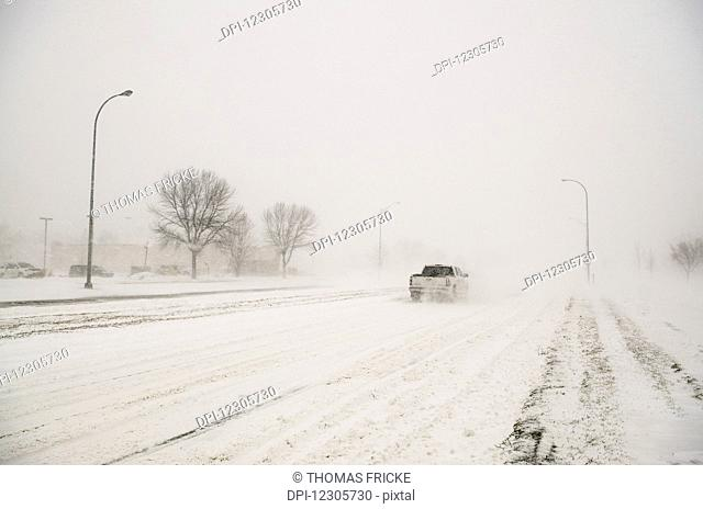 A truck driving through a blizzard; Grand Forks, North Dakota, United States of America