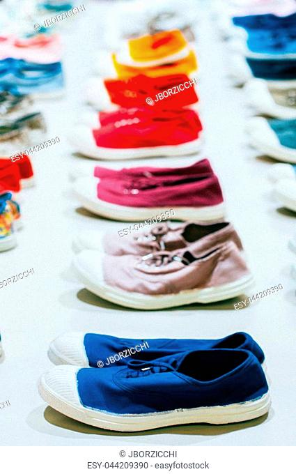 A many of colorful sneakers, gym shoes, woman running shoes
