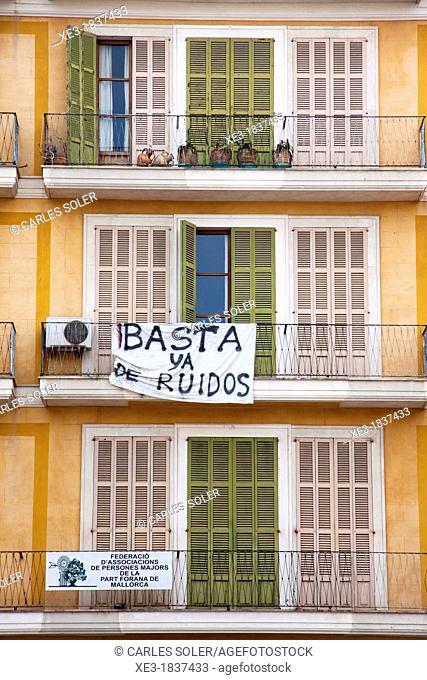 'Stop noise' banner on a residential building. Palma, Majorca, Balearic Islands, Spain