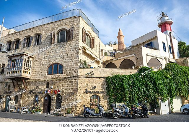 apartment houses in Jaffa, oldest part of Tel Aviv city, Israel. View with lighthouse on the right side