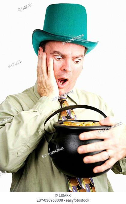 Irish man dressed as leprechaun, excited to be getting a pot of gold coins. White background