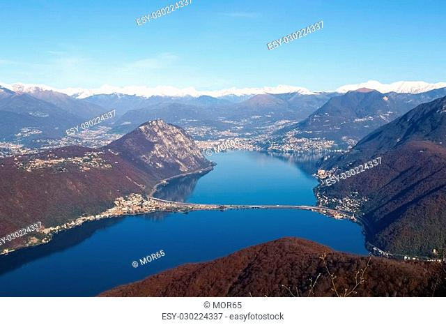 Mont St. Giorgio, Switzerland: Images of the Gulf of Lugano city with a gorgeous sunny day in November. You can see the Alps covered by snow with a blue sky