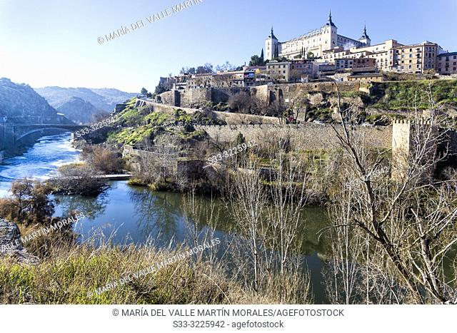 Alcalzar of Toledo from river Tajo on a winter sunny day. Spain. Europe