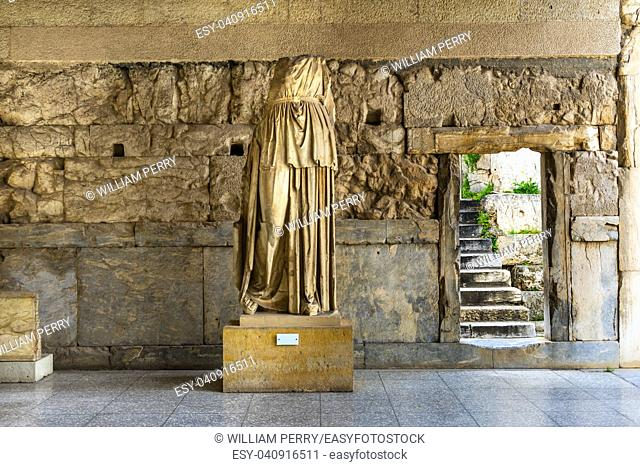 Ancient Female Statue Stoa of Attalos Agora Market Place Athens Greece. Agora founded 6th Century BC. Stoa built in 150 BC, rebuilt early 1950s