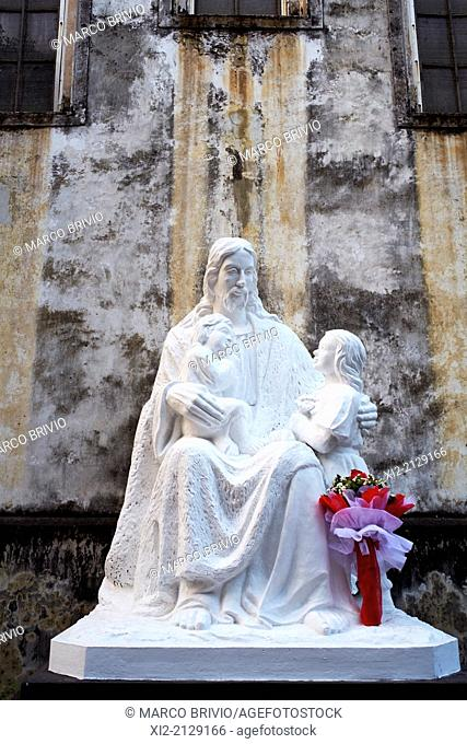 Statue of Jesus Christ and the holy family at the Cathedral Parish of Hanoi, Vietnam