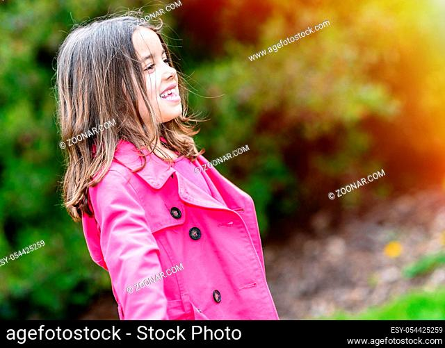 Portrait of happy cute child standing in a park