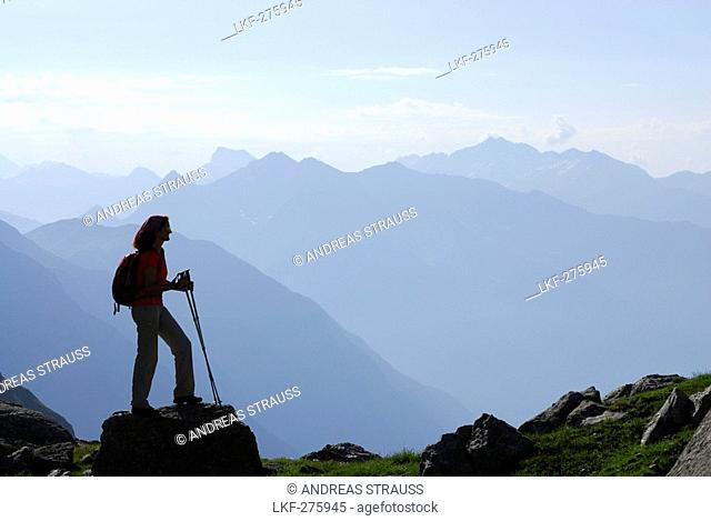 Female hiker enjoying view over Stubai Alps, Trentino-Alto Adige/South Tyrol, Italy