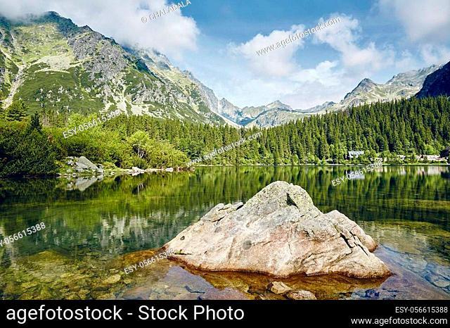 Beautiful lake against rocky mountains. Popradske pleso in High Tatras, Slovakia