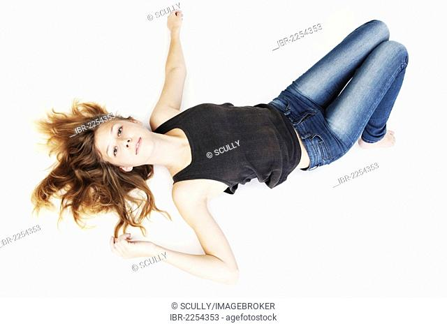 Young woman, lying on the floor