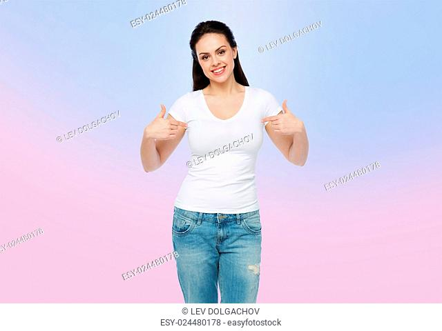 advertisement, clothing and people concept - happy smiling young woman or teenage girl in white t-shirt pointing finger to herself over rose quartz and serenity...