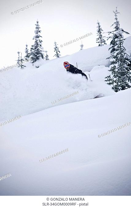 Snowboarder riding down mountainside