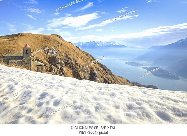 Last snow at San Bernardo Church, Monte Bregagno, Dongo, Como Lake, Lombardy, Italy, Europe