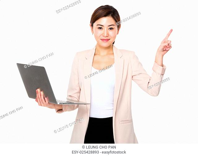 Young businesswoman hold with notebook computer and finger pointing up