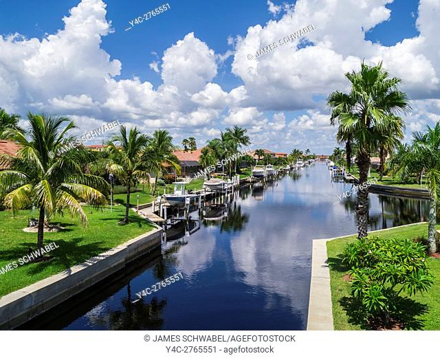 Boats on canals in residential neighborhood of Punta Gorda on the Gulf Coast of Florida