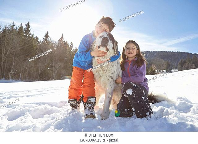 Brother and sister with their pet dog