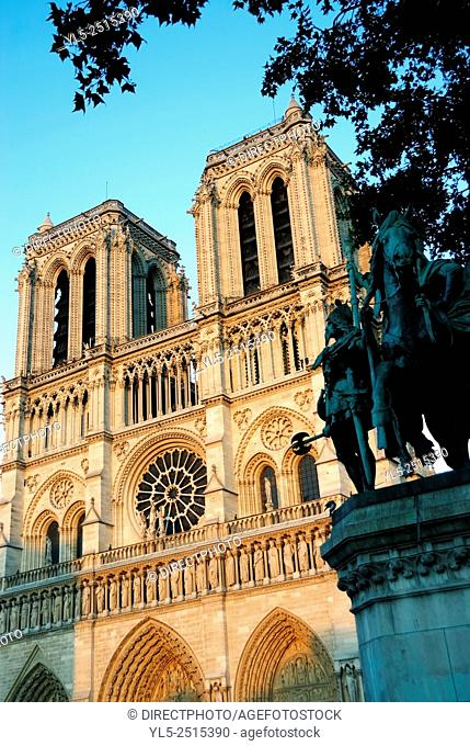 Paris, France, Religious Architecture, Notre Dame Cathedral, Front, Towers in Sunset light, Statue