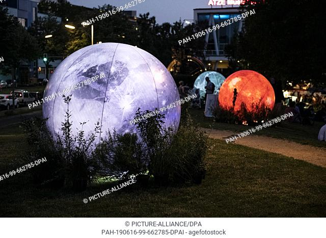 """15 June 2019, Berlin: During the """"""""Long Night of Science"""""""", visitors were able to walk past oversized spheres representing the planetary system"""