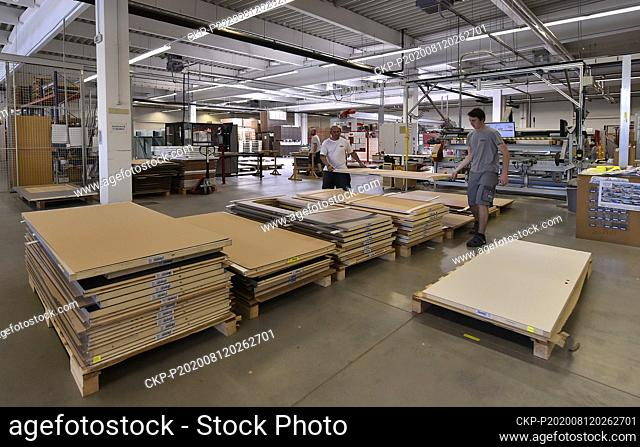 Employees of Czech company Sapeli complete doors in production hall in plant in Jihlava, Czech Republic, August 7, 2020. (CTK Photo/Lubos Pavlicek)