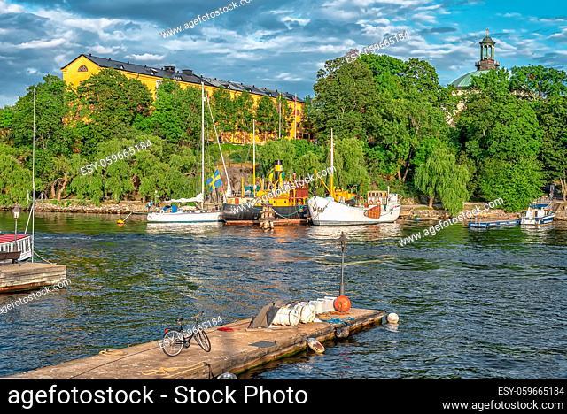 STOCKHOLM/SWEDEN - AUGUST 2, 2019: View on coastline of Skeppsholmen island with boats and ships