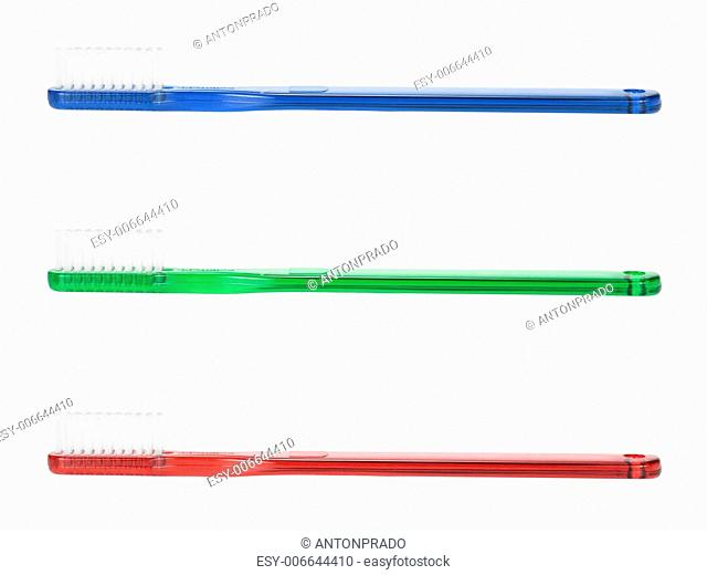 A blue, a green and a red toothbrush isolated on white background