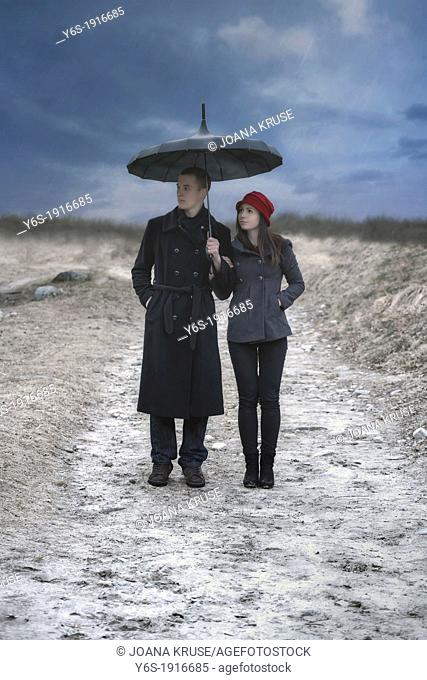 a couple is doing a walk in the rain