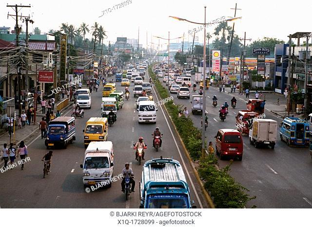 Peak hour traffic on Pusok St  Lapu-Lapu City, Metro Cebu, Mactan Island, Visayas, Philippines