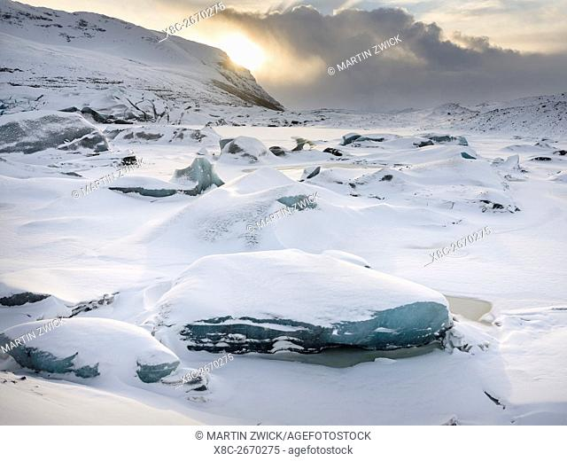 Glacier Svinafellsjoekul in the Vatnajoekull NP during winter. The glacier front and the frozen glacial lake. europe, northern europe, iceland, February
