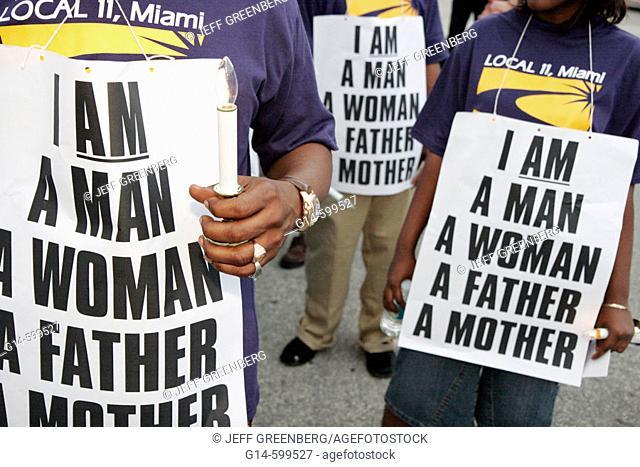SEIU labor union members, poster. Interfaith Prayer Vigil & March. Martin Luther King Day. Miami Beach. Florida. USA